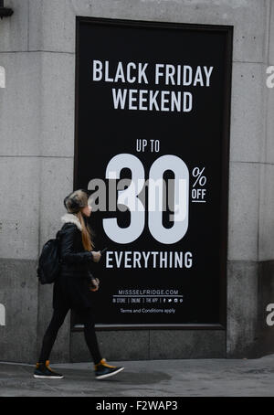 Black Friday signs in shop windows in Oxford St, London uk - Stock Photo