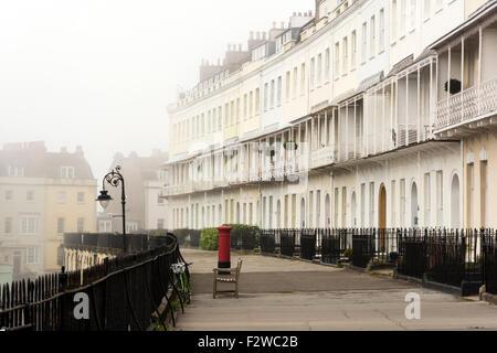 Royal York Crescent, a georgian terrace in Clifton, Bristol on a foggy morning. - Stock Photo