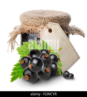 Black currant and jam in jar isolated on white - Stock Photo
