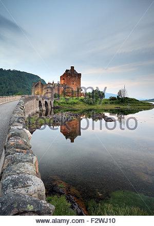 Eilean Donan castle reflecting on Loch Duich. - Stock Photo