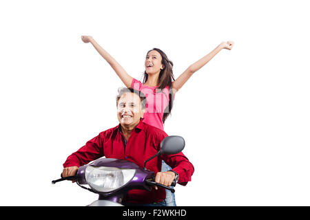 2 indian father and young daughter Scooty Riding fun enjoy - Stock Photo