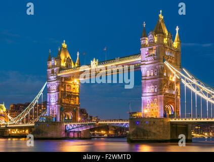 Illuminated lit up Tower Bridge at night and River Thames City of London England GB UK EU Europe - Stock Photo
