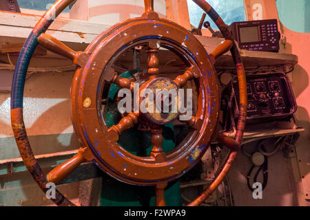 Wooden steering wheel at bridge of fishing boat in the Port Musée, boat museum at Douarnenez, Finistère, Brittany, - Stock Photo