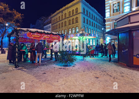 RIGA, LATVIA - DECEMBER 28, 2014: People at the Christmas market in the heart of Riga's Old Town on December 28, - Stock Photo