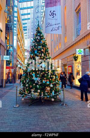 RIGA, LATVIA - DECEMBER 28, 2014: Traditional symbol of Christmas - beautifully decorated Christmas fir tree in - Stock Photo