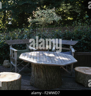 Patio Chairs Made From Wooden Logs Arranged In A Circle