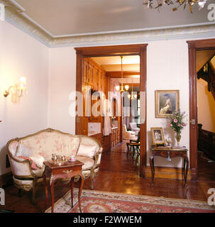 Antique French style sofa in luxurious nineties bedroom - Stock Photo