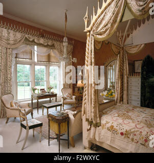 ... Swagged Curtains On Window In Opulent Bedroom With Silk Drapes On A  Gothic Style Four Poster