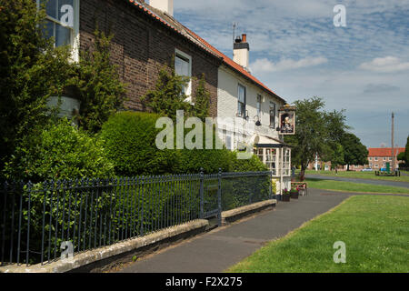 Sunny summer view of attractive, traditional, old, English rural pub (The Lord Collingwood) - Upper Poppleton village - Stock Photo