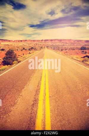 Retro vintage filtered picture of a country highway, USA. - Stock Photo