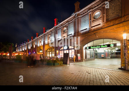 Germany, Berlin, Hackescher Markt train station with bars and restaurants on the ground floor - Stock Photo