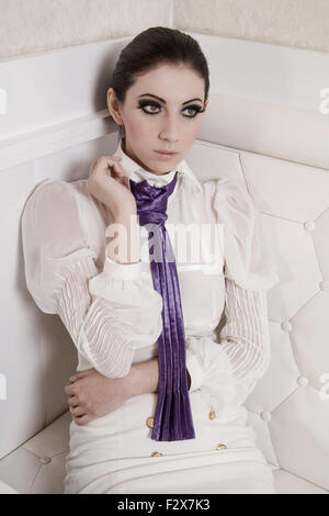 Portrait of fashionable young woman in white clothes - Stock Photo