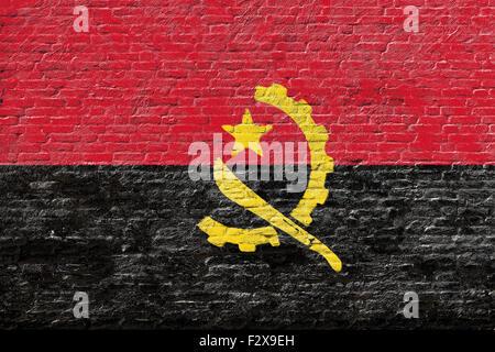 Angola - National flag on Brick wall - Stock Photo