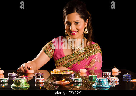 1 indian Adult Woman Diwali Festival Decoration  Diya - Stock Photo