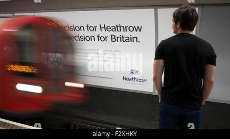 Heathrow expansion advertising hoarding poster on London underground - Stock Photo