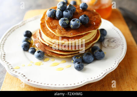 american pancakes with syrup on plate - Stock Photo