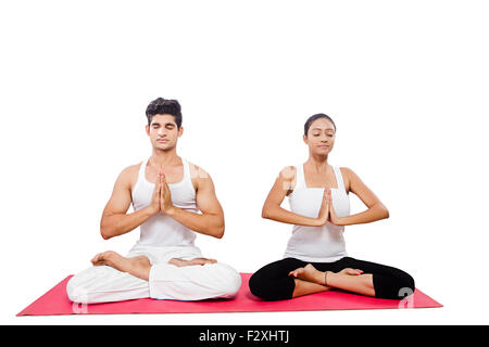 two couple yoga suryanamaskar meditating standingonone