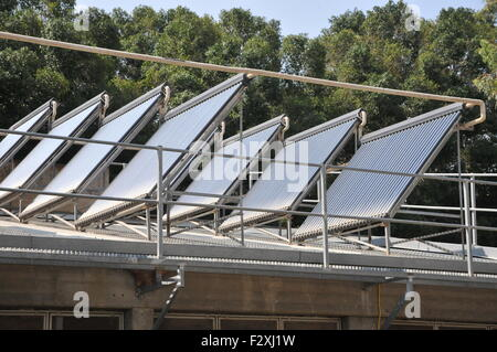 Electricity converting solar panels on a roof of a shed. With the reduction on cost of ownership of these panels, - Stock Photo