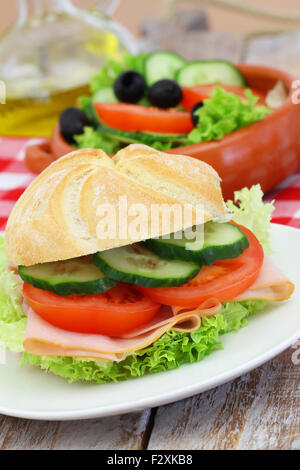 Healthy lunch consisting of ham roll and green salad - Stock Photo