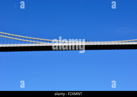 Bristol, UK. 25th September, 2015. Workmen seen Walking along the TOP of the Main Support of World Famous Clifton - Stock Photo