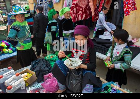 Ethnic Hmong tribe, shopping at Muong Hum market, Vietnam. - Stock Photo