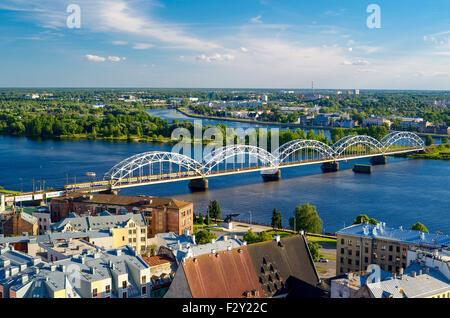 Railway bridge over the Daugava river in Riga - Stock Photo