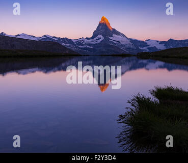 Alpenglow at dawn on Matterhorn (Cervino) mountain peak. View from Lake Stellisee, lake reflection. Zermatt, Swiss - Stock Photo