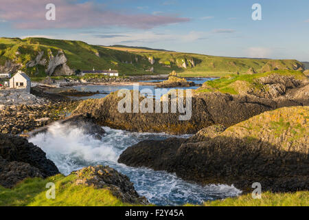 Early morning on the rocks overlooking Ballintoy, County Antrim, Northern Ireland, UK - Stock Photo