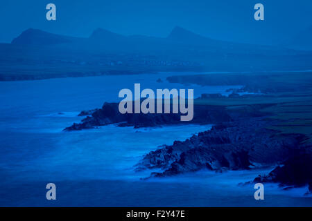 Pre-dawn view over Ballyferriter Bay, Sybil Point and the peaks of the Three Sisters, Dingle Peninsula, County Kerry, - Stock Photo