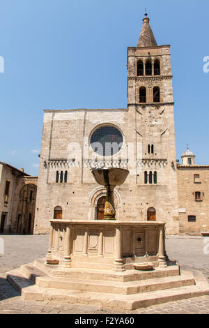 Silvestri square with its church and fountain in Bevagna, Umbria - Stock Photo