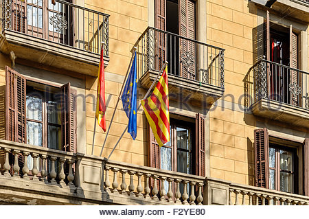 Flags of European Union, Spain and Catalonia outside a building in Barcelona. - Stock Photo