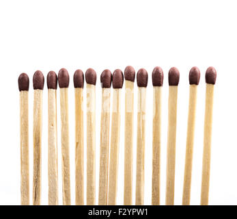 Line of matches isolated on white - Stock Photo
