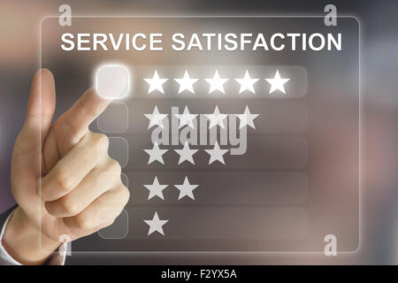 business hand clicking service satisfaction on virtual screen interface - Stock Photo