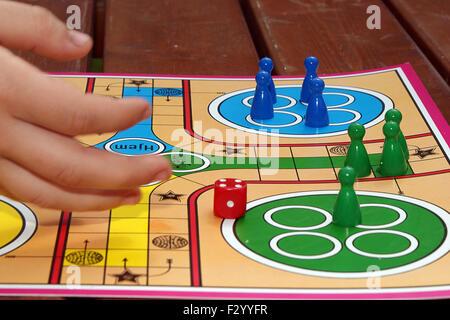 Playing ludo. - Stock Photo