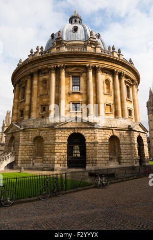 Radcliffe Camera building, with sun on a sunny day with blue sky / skies; part of Oxford University. Oxford. UK. - Stock Photo