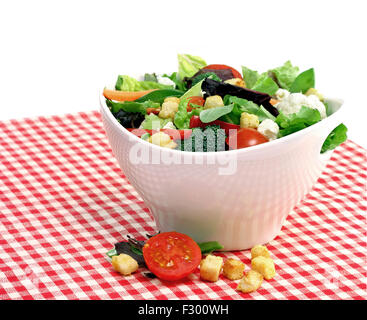 A large white bowl of mixed vegetable salad. - Stock Photo