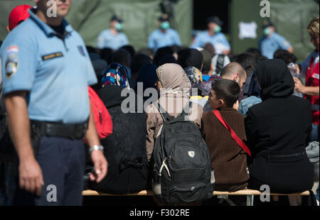 Opatovac, Croatia. 21st Sep, 2015. Refugees wait for their registration in front of a tent at a tent camp for refugees - Stock Photo