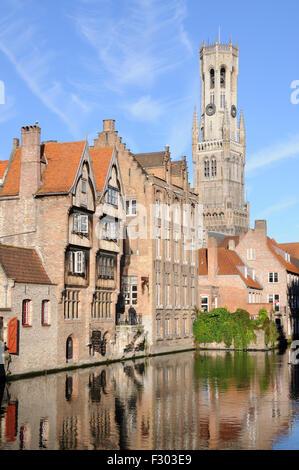 Morning view of the Belfry from the Rozenhoedkaai in Bruges, West-Vlaanderen, Belgium - Stock Photo