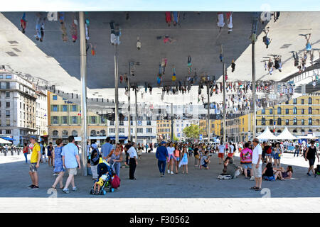Marseille France Vieux Port Ombriere mirror people image reflections under Norman Fosters canopy in Old Port of - Stock Photo