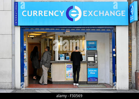 Bureau de Change International Currency Exchange retail booth & atm in premises in Oxford Street West End of London - Stock Photo