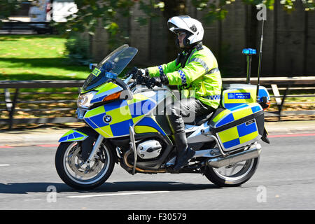 Metropolitan Police officer patrolling on a BMW motorbike in Park Lane London England UK - Stock Photo