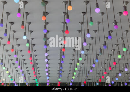 Installation of multi-colored light bulbs on the ceiling - Stock Photo