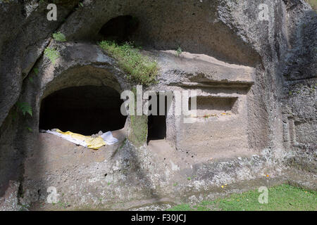Monk cave at Gunung Kawi temple, Tampaksiring, Bali, Indonesia - Stock Photo