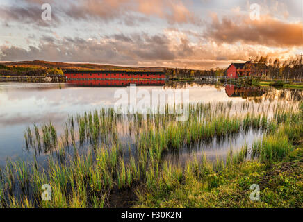 Iconic wooden bridge on Narsjoen lake in Hedmark county,  Norway at sunset - Stock Photo