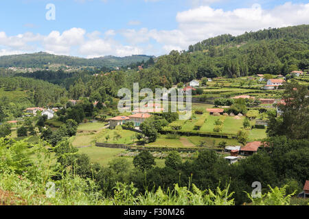 View on houses in the countryside at Paredes de Coura in Norte region, Portugal - Stock Photo