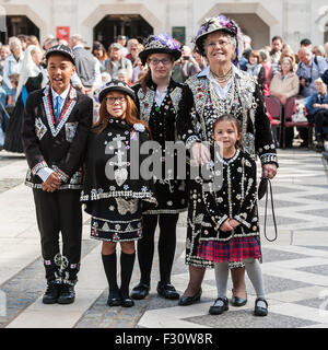 London, UK.  27 September 2015.  Pearly Kings and Queens, dressed in their traditional dark suits covered in hundreds - Stock Photo