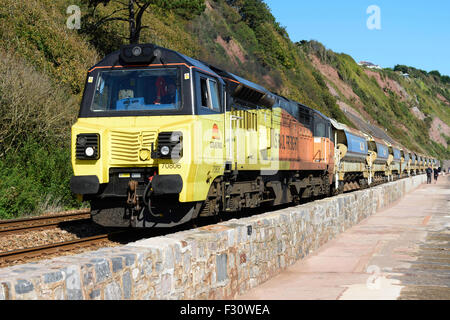 Class 70 diesel locomotive 70806 hauls a freight train past the sea wall Teignmouth south Devon UK - Stock Photo