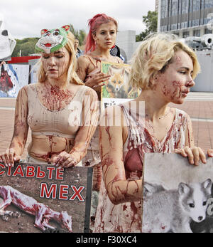 Kiev, Ukraine. 27th Sep, 2015. Girls depicting carcasses of fur animals, are showing a victim's fur industry, during - Stock Photo