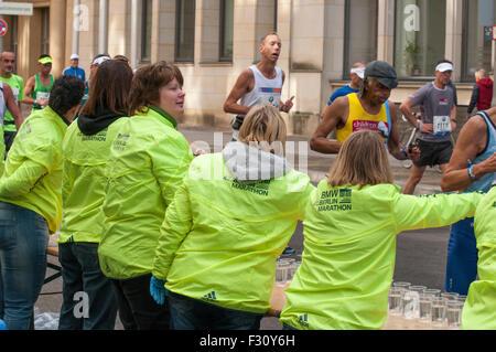 Berlin, Germany. 27th Sep, 2015. Volunteers serve drinks at the 42nd Berlin Marathon, 2015 Credit:  Philip Game/Alamy - Stock Photo