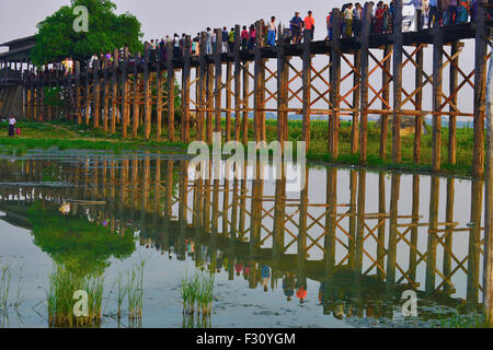 Sightseers and tourists crossing the famous 1.2km U Bein wooden bridge which spans the Taungthaman Lake near Amarapura,Myanmar,(Burma), - Stock Photo